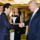 This handout picture  released by Japan s Cabinet Secretariat on November 18  2016 shows Japanese Prime Minister Shinzo Abe  2nd L  being welcomed by US President-elect Donald Trump  R  beside Ivanka Trump  C  and her husband Jared Kushner  L  in New York  Abe voiced confidence on November 17 about Trump as he became the first foreign leader to meet the US president-elect  who was narrowing in on cabinet choices    AFP PHOTO   Cabinet Secretariat   HO   HANDOUT RESTRICTED TO EDITORIAL USE - MANDATORY CREDIT  AFP PHOTO   CABINET SECRETARIAT  - NO MARKETING - NO ADVERTISING CAMPAIGNS - DISTRIBUTED AS A SERVICE TO CLIENTS