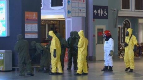 Malaysian security personnel investigate the crime scene at Kuala Lumpur airport