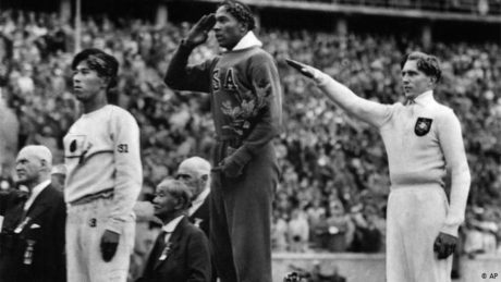Jesse Owens receives his gold medal at the 1936 Berlin Olympics